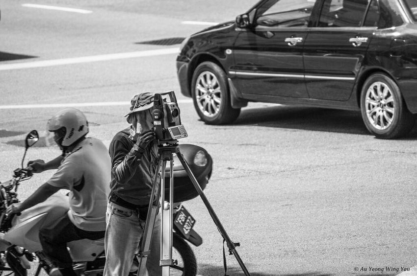 Surveyor With Theodolite. Singapore Working Surveyor Street Photography Streetphotography Streetphoto_bw Measuring