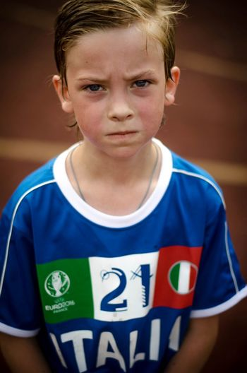 Portrait of cute boy in soccer jersey