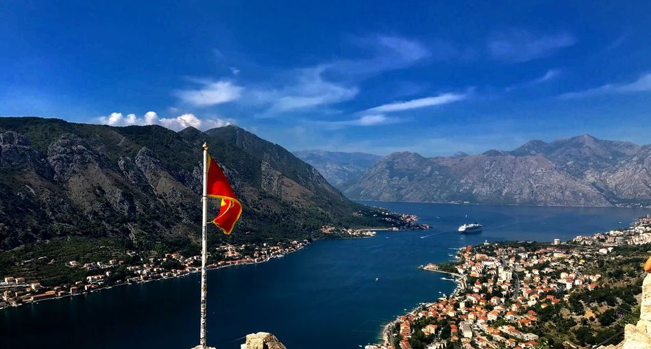 KOTOR Water Sky Patriotism Flag Nature Mountain Day No People Transportation Mountain Range Nautical Vessel Scenics - Nature Beauty In Nature Cloud - Sky Outdoors National Icon Blue Sea