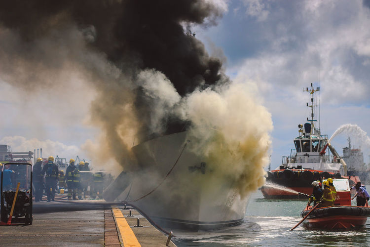 The Photojournalist - 2017 EyeEm Awards Smoke - Physical Structure Spraying Danger Accidents And Disasters Destruction Water RISK Firefighter Outdoors Nautical Vessel Day People Riot Sky Indian Ocean Portlouis  Mauritius BYOPaper! EyeEm Best Shots Photooftheday