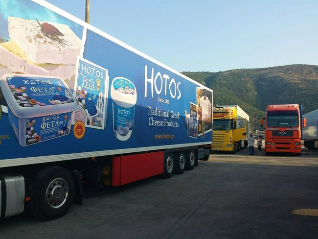 What's For Dinner? Fetacheese Greek Export Hit Advertising Brand Blue Red n Yellow Trucks Waiting for Embarkation Harbourside Dock 10 Harbour On The Dock Igoumenitsa