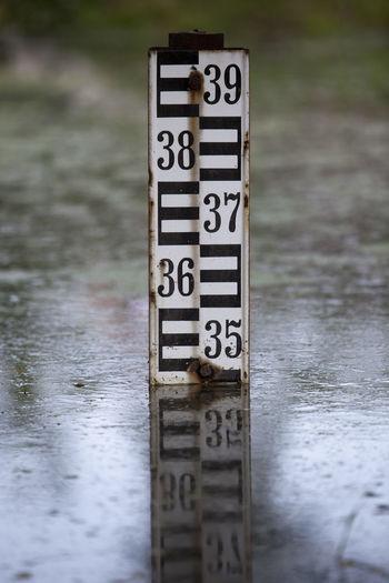 Water level indicator High Indicator Measuring RISK Rain River Level Marker Streamflow Control Dam Danger Flood Flood Level Indicator Flooding Lake Level Low Measure Measurement Numbers Outdoors River Water Water Level Indicator