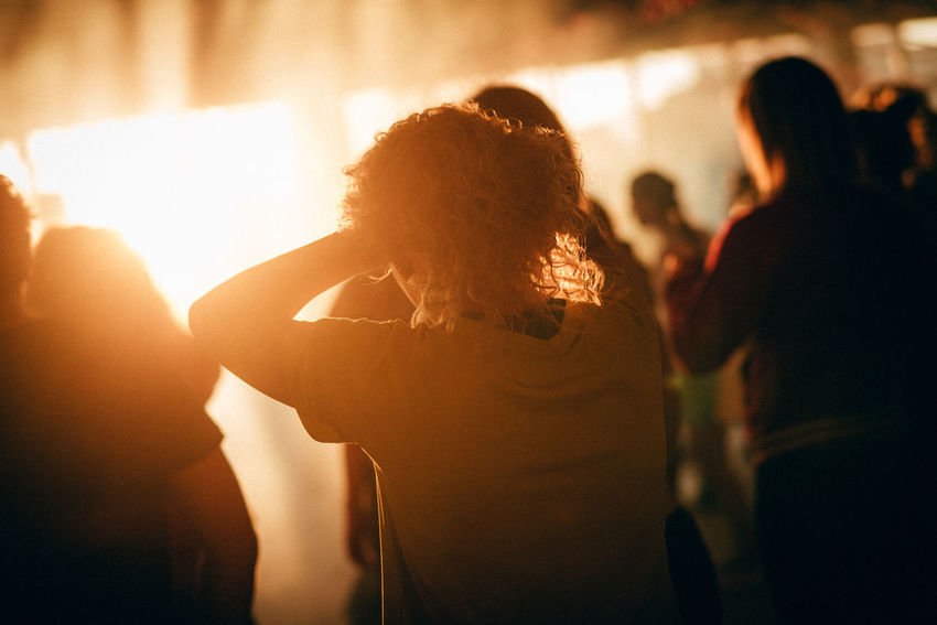 Morning Morning Light Adult Arts Culture And Entertainment Atmospheric Mood Audience Crowd Enjoyment Focus On Foreground Hand On Hair Illuminated Indoors  Large Group Of People Lifestyles Nightlife People Real People Sunset Togetherness Women