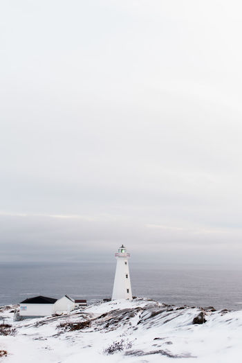 Cape spear lighthouse by sea against sky