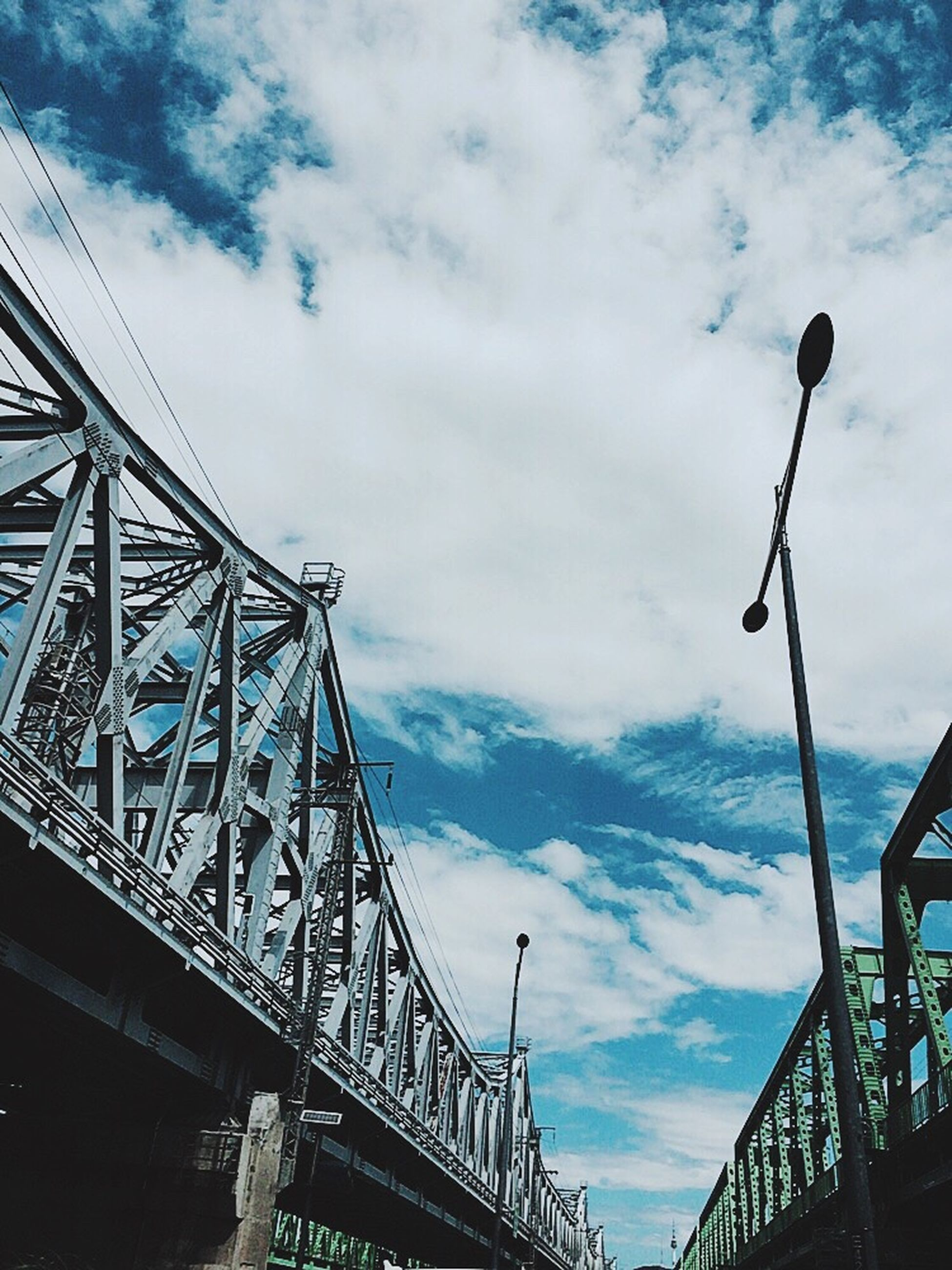sky, cloud - sky, architecture, low angle view, travel destinations, building exterior, outdoors, no people, built structure, day, connection, city, bridge - man made structure