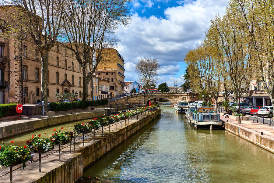 The Canal de la Robine in Narbonne city. Languedoc-Roussillon, France Architecture Aude Barge City City Canal City Center Cloud - Sky Embankment Footbridge France Landscape Languedoc-Roussillon Midi-Pyrénées Narbonne Outdoors Quay River Sky Springtime Sunny Day The Canal De La Robine Tourism Destination Town Travel Destinations Urban Landscape Western Europe