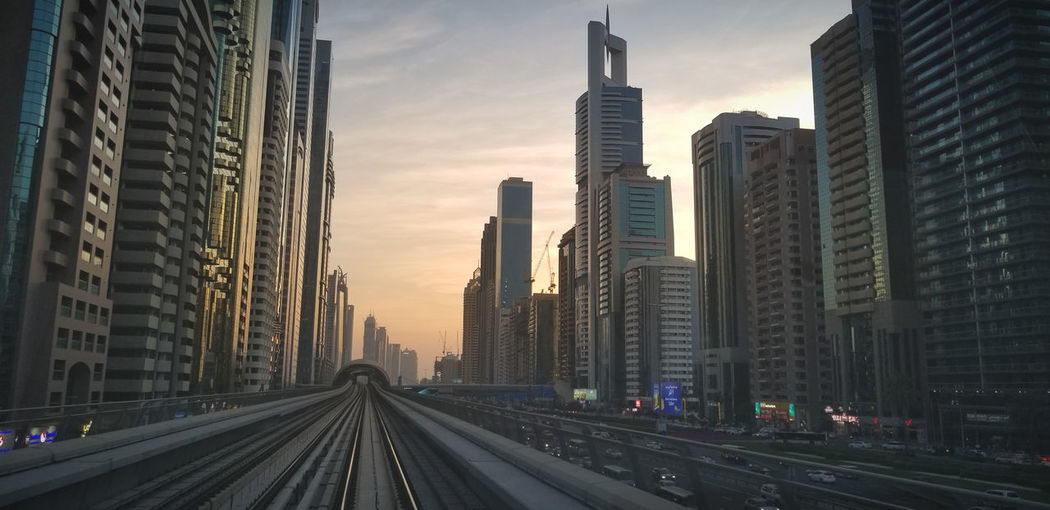 View of city buildings at sunset in dubai