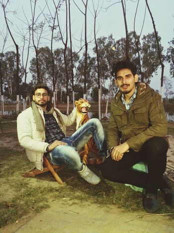 Two People Sitting Togetherness Happiness Looking At Camera Only Men Eyeglasses  Full Length Adults Only Smiling