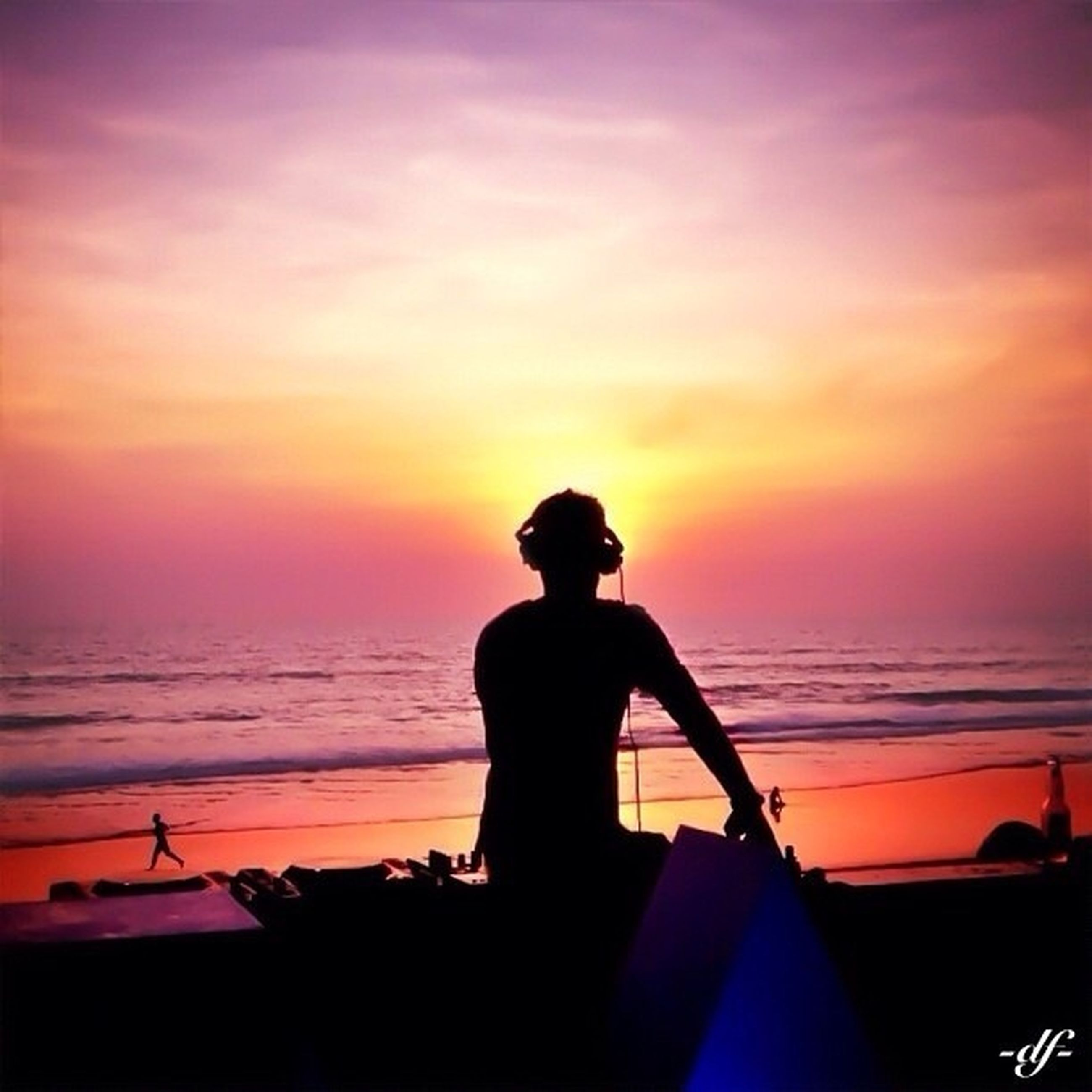 sunset, sea, horizon over water, silhouette, water, orange color, sky, beach, lifestyles, leisure activity, scenics, beauty in nature, shore, standing, idyllic, men, tranquility, tranquil scene