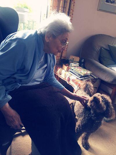 Man and dog sitting at home
