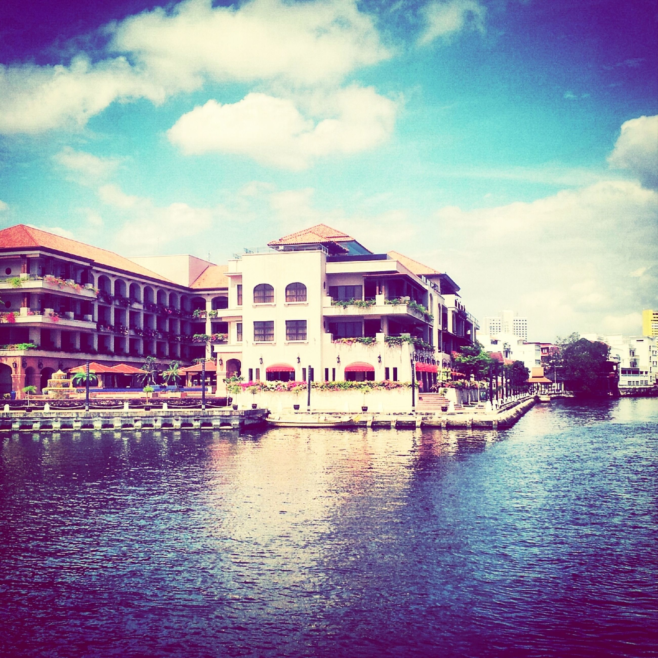 architecture, building exterior, built structure, water, sky, waterfront, cloud - sky, cloud, nautical vessel, reflection, incidental people, city, building, outdoors, day, residential building, residential structure, house, transportation, cloudy