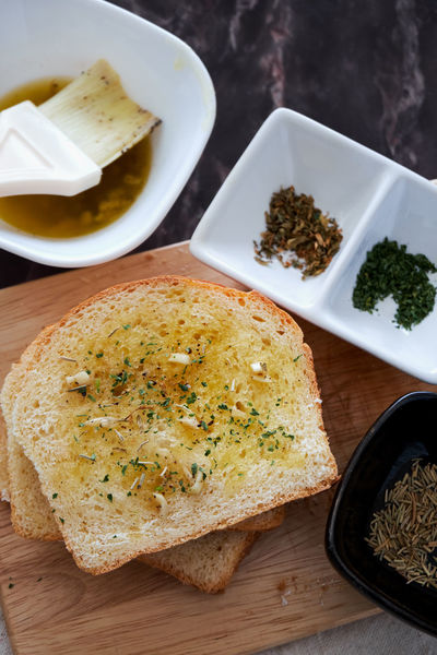 Ingredients Bread Brush Close-up Day Food Food And Drink Freshness Garlic Bread Healthy Eating Indoors  No People Plate Ready-to-eat Sliced Bread Spread Toasted Bread