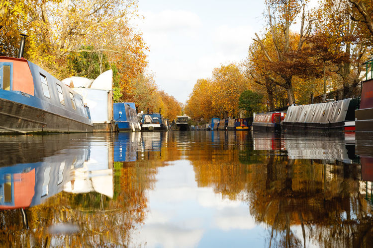 Autumn in London Water Reflection Tree Plant Autumn Nautical Vessel Transportation Mode Of Transportation Nature Waterfront Day Sky Change Lake No People Moored Architecture Outdoors London Travel Autumn Travel Destinations Autumn colors Reflection Autumn Leaves