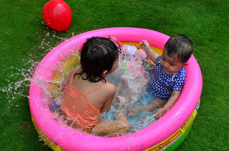 Girl playing in a home swimming pool on a hot summer day! Childhood Enjoy Enjoyment Friendship Fun Girl Happiness Happiness Hot Kindergarten Laughing Leisure Activity Playful Playing Pool Pool Time Sisters Splash Splashing Summers Swimming Toddler  Vacations Water Wet