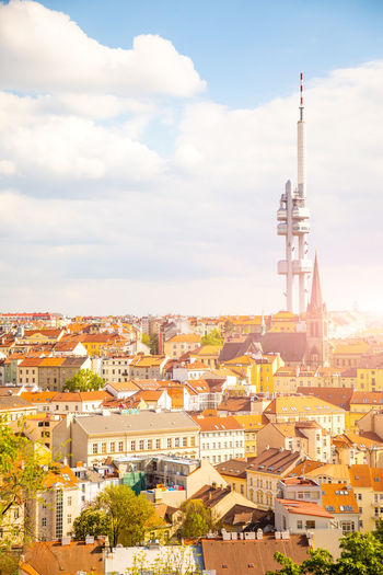 Prague, Czech Republic - 6.05.2019: View from the top of the Vitkov Memorial on the Prague landscape on a sunny day with the famous Zizkov TV tower on the horizon Tower Architecture City Cityscape Landmark Travel View Prague Landscape Sky Urban Tv Capital Skyline Tourism Žižkov Czech Aerial Europe Outdoor Praha Roof Architectural Buildings Czechoslovakia Day Daylight Daytime Detail Generic Historical History Horizon Houses Medieval Natural Outside Republic Rooftops Sightseeing Summer Sunny Unesco Building Elevated Heritage Historic Light Weather Television