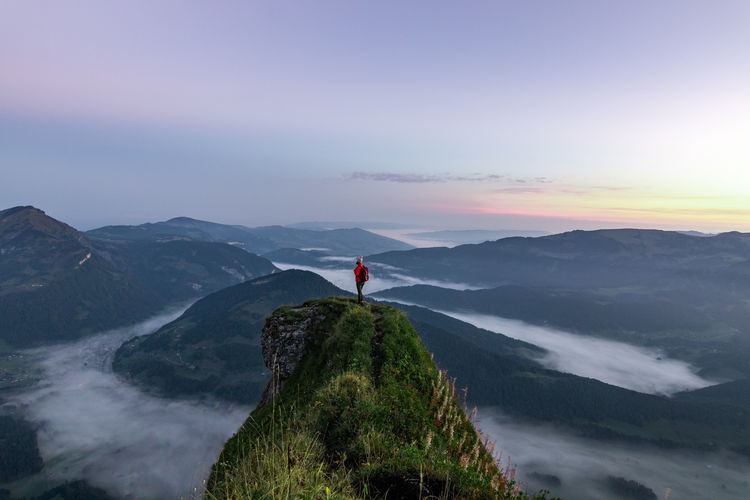 Sunrise at a mountain peak in Austria with fog in the valley. Wonderful landscape. Sky Mountain Tranquility Scenics - Nature Beauty In Nature One Person Tranquil Scene Non-urban Scene Nature Standing Adventure Red Idyllic Leisure Activity Holiday Environment Vacations Sunset Limb Human Arm Mountain Range Freedom Outdoors Looking At View Human Limb My Best Photo