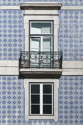 renovated facade with classical tiles in Lisbon Architecture Classic Façade Railing Reflection Renovation Sunlight Balcony Blue Building Exterior Built Structure Close-up Day Door Full Frame Glass House Lisbon Old Outdoors Pattern Power Cable Refurbished Tiles Window