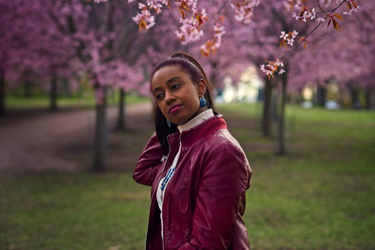 Portrait of beautiful young woman standing in park