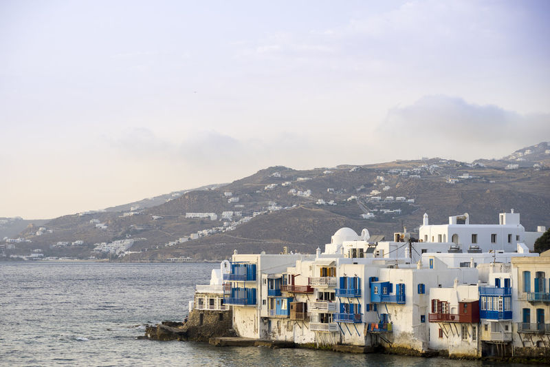 Mountain Architecture Building Exterior Built Structure Building Sky Water Nature Day Mountain Range Scenics - Nature No People Residential District City Cloud - Sky Outdoors House Beauty In Nature Sea Mykonos,Greece Mykonos Island