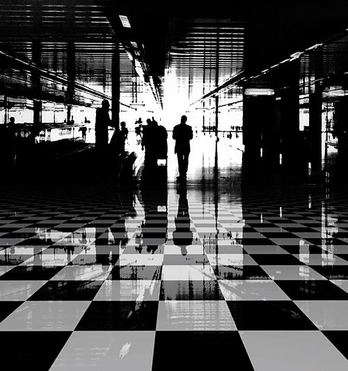 Airport Black & White Blackandwhite EyeEm Bnw EyeEm Best Shots - Black + White Black And White Travel Traverler Walking Around Walking Around Taking Pictures Airport Airportphotography People Watching People Public Transportation Lonely Silhouette Silhouette_collection Patterns Squares And Rectangles Square Geometric Shapes Geometry Reflection Shadow