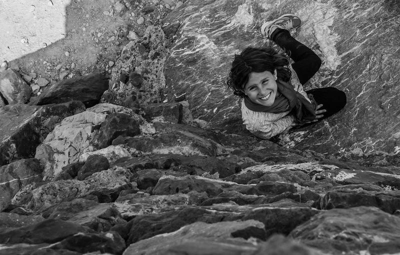 Black And White Day Full Length Happiness Leisure Activity Lifestyles Looking At Camera Nature Nature Photography One Person Outdoors People Portrait Portrait Of A Woman Real People Rock - Object Shadows & Lights Smile Smiling Stone The Portraitist - 2017 EyeEm Awards Water Young Adult Young Women