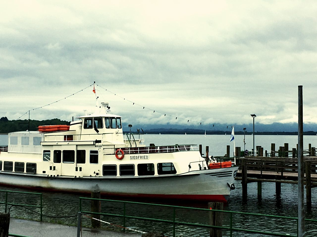 sky, transportation, nautical vessel, water, cloud - sky, mode of transport, outdoors, no people, moored, day, sea, nature, built structure, travel destinations, architecture, harbor, mountain, beauty in nature