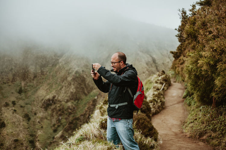Man photographing on mountain