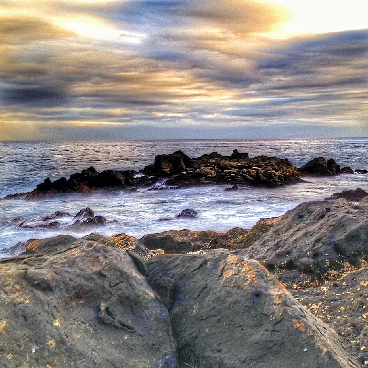 sea, sky, horizon over water, rock - object, nature, cloud - sky, water, beauty in nature, scenics, sunset, rock, wave, no people, beach, outdoors, motion, tranquility, day