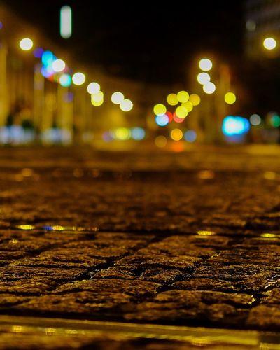 night city bokeh Night Illuminated Water No People Wet Reflection Glowing Street Lighting Equipment City Light - Natural Phenomenon Rain Road Surface Level Outdoors Rainy Season Light