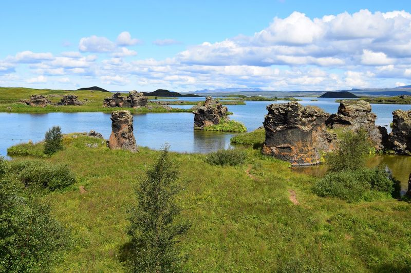 Scenic view of lake myvatn against cloudy sky