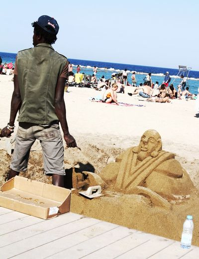 Adult Adults Only Arts Culture And Entertainment Beach Creating Day Large Group Of People Only Men Outdoors People Sand Sand Art Sand Art On The Beach Sea Sky Water