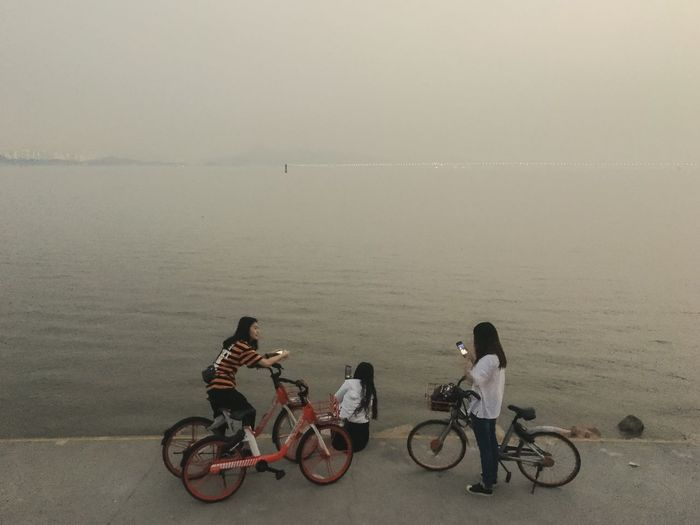 Shenzhen, China 2019 Street Of China Streetphotography Iphone6s VSCO IPhoneography Mobilephotography Transportation Childhood Water Child Bicycle Group Of People Girls Full Length Mode Of Transportation Togetherness High Angle View Leisure Activity Females Outdoors