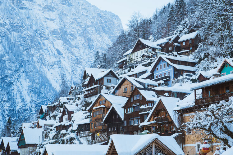 Snow covered residential district by mountain