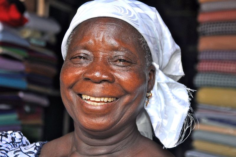 Africa African Beauty Close-up Content Fabrics Faces Of Africa Faces Of The World Focus On Foreground Friendly Front View Ghana Happy Happy People Headshot Laughing Market Place Market-woman Mature Adult Person Selling Smiling Toothy Smile Woman Woman Portrait Inner Power