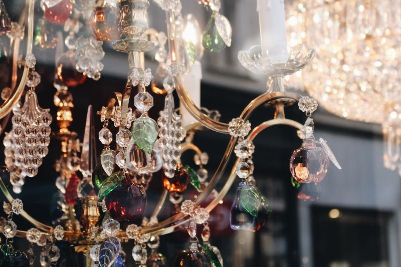 Close-up of illuminated chandelier hanging at store