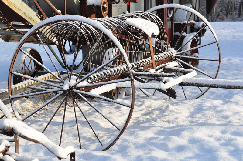 Wagon Wheel On Snow Covered Field