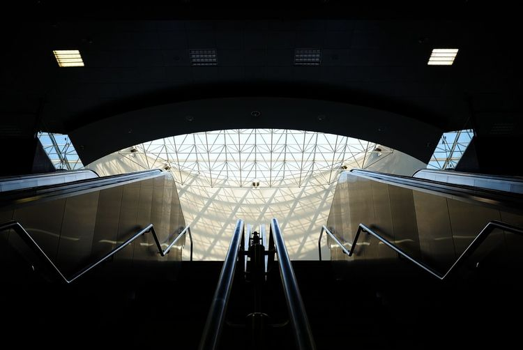 Low angle view of subway station escalator