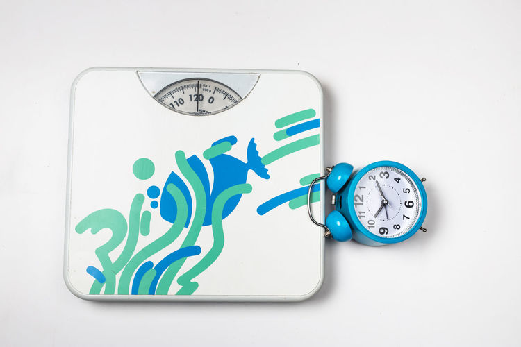 White Background Indoors  Still Life Studio Shot No People Communication Green Color White Color Clock Number Close-up Cut Out Time Blue Copy Space Accuracy Animal Representation Representation Text Shape