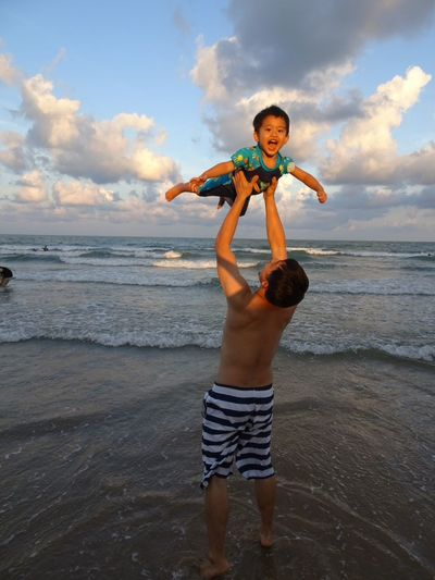 Beach Child Boys Childhood Fun Sea Males  Vacations Sand Motion Father Shirtless Enjoyment Playing Son Human Body Part Children Only Cloud - Sky People Sky Fatherandson Father And Son