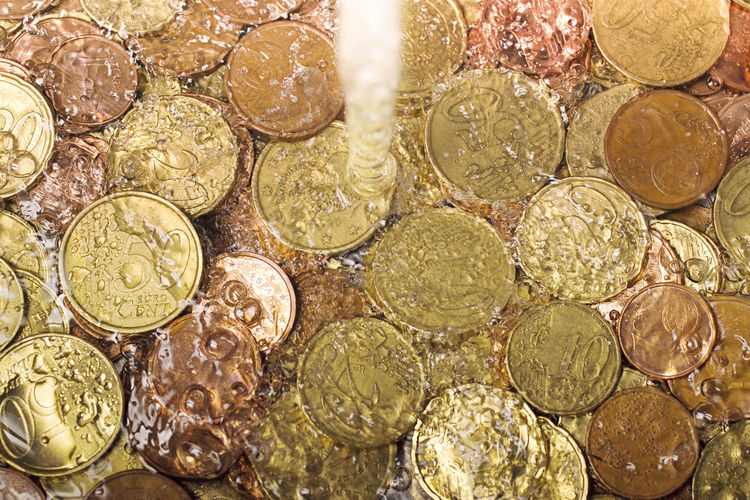 money laundering concept , coins under tap water , black money Money Laundering Money Laundry Money Money Money Money Black Money Currency Currency Symbol Business Economy Crisis No People Coin Backgrounds Finance Metal Close-up Gold Colored Abundance