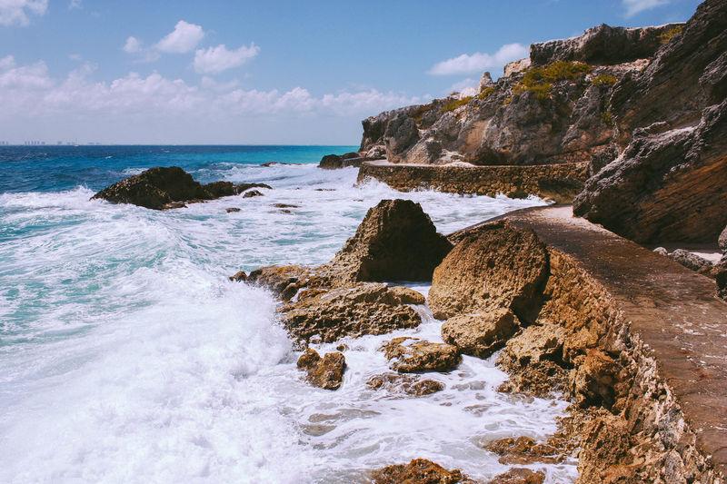 Waves Splashing At Rocky Shore