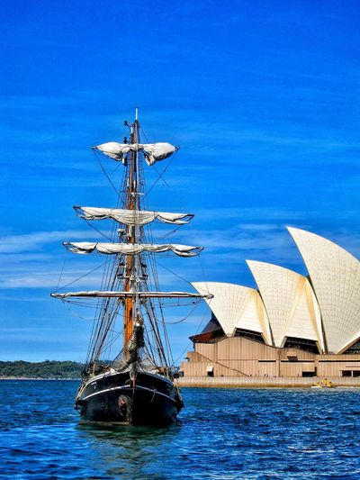 One of the best harbors and the most recognizable iconic opera houses in the world. My favorite city Sydney, Australia! Nautical Vessel Transportation Water Sailboat Harbor Sea Mast Tall Ship Outdoors Operahouse Architecture Iconic Ocean Culture Music Orchestra Orchestra Concert  Concert Music Venue EyeEmNewHere Historical Building Historic Blue Architecturelovers Architectural Detail