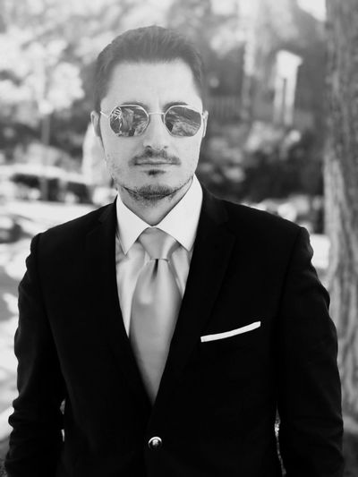 Portrait of businessman wearing sunglasses while standing outdoors