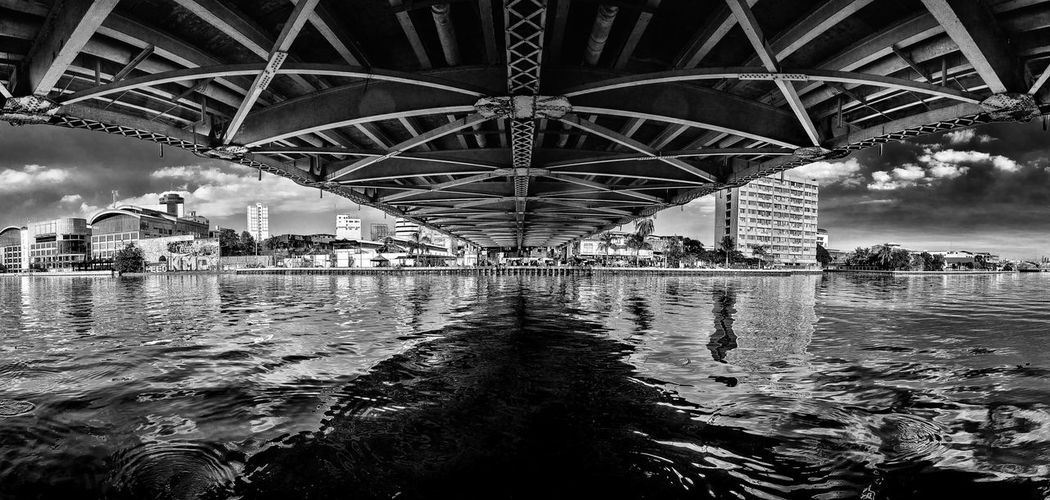 Underside of Quezon bridge Bridge Architecture Built Structure Water Sky Reflection Nature No People Travel Low Angle View Pattern Day