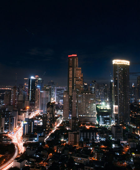 Night. Illuminated Modern Architecture Downtown District Skyscraper Urban Skyline No People Light Trail Travel Destinations City Life Cityscape City Night Mandaluyong City Manila Phillipines Tivoli Garden Cityscape Financial District  Modern Outdoors Futuristic