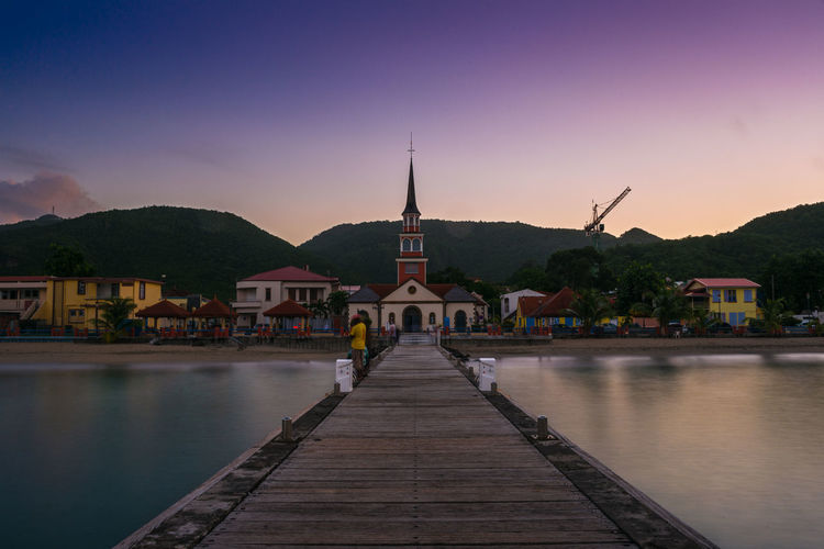 Pier in Les Anses-d'Arlet, Martinique Antilles Architecture Building Exterior Caribbean Church Coast Dawn Fishing French Long Exposure Martinique Morning Outdoors Pier Place Of Worship Sea Sky Sunrise Town Water
