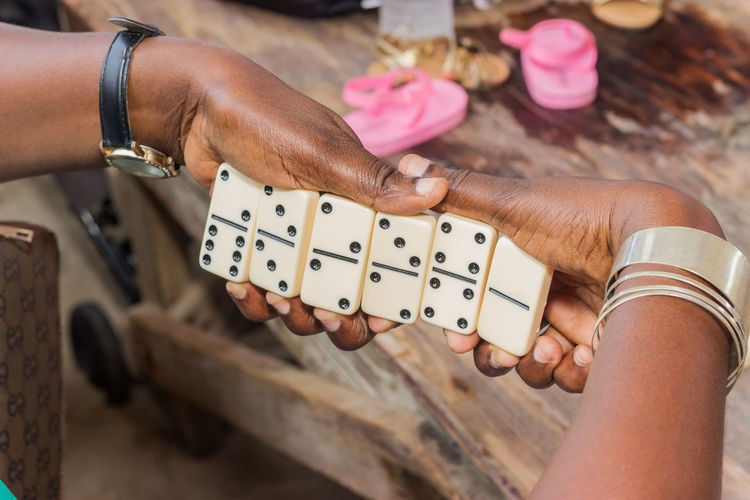Close-up of woman holding dominos