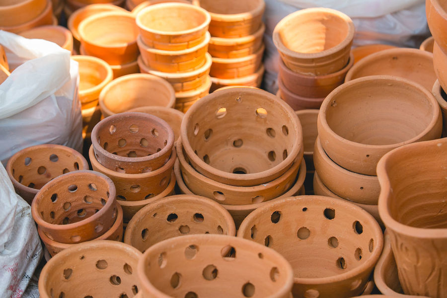 product Hand-made Abundance Art And Craft Art And Craft Product Baked Clay Close-up Craft Day Dish Handmade Indoors  Large Group Of Objects No People Plate Pottery Product Stack