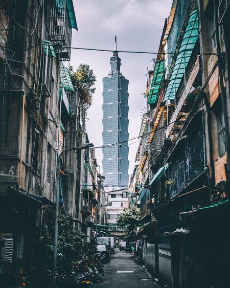 Street amidst city against sky