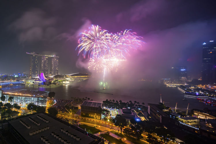 Fireworks show at Marina Bay Singapore Architecture Building Exterior Built Structure Celebration City Cityscape Event Firework - Man Made Object Firework Display Illuminated Night No People Outdoors Sky Skyscraper Urban Skyline